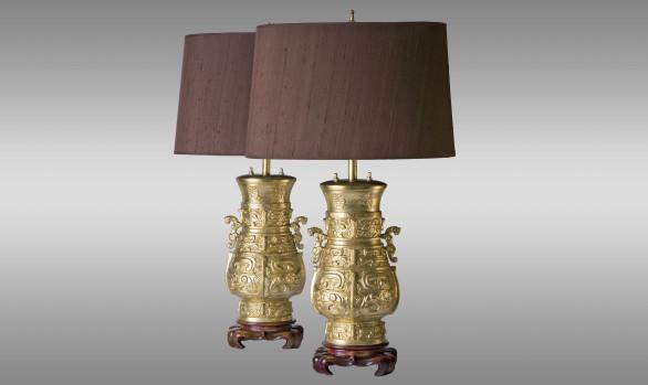 Pareja de Lámparas<br/> en bronce dorado y madera