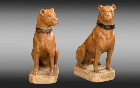 Pair of painted dogs <br/>made in reconstituted stone<br/> Nineteenth Century