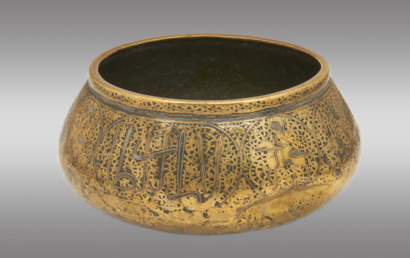 A silver inlay Islamic brass water bowl<br/> Sixteenth Century