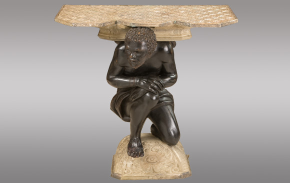 Console <br/>with a carved figure of Blackamoor<br/>and topped with silvered copper