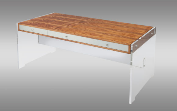 Desk in rosewood and lucite<br/> Designed by Poul Norreklit