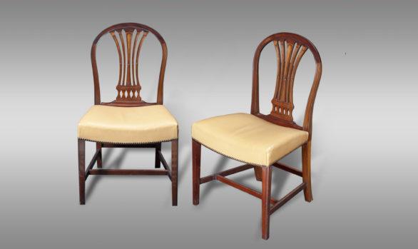 12 Sillas estilo Jorge III <br/> en caoba. Siglo XIX